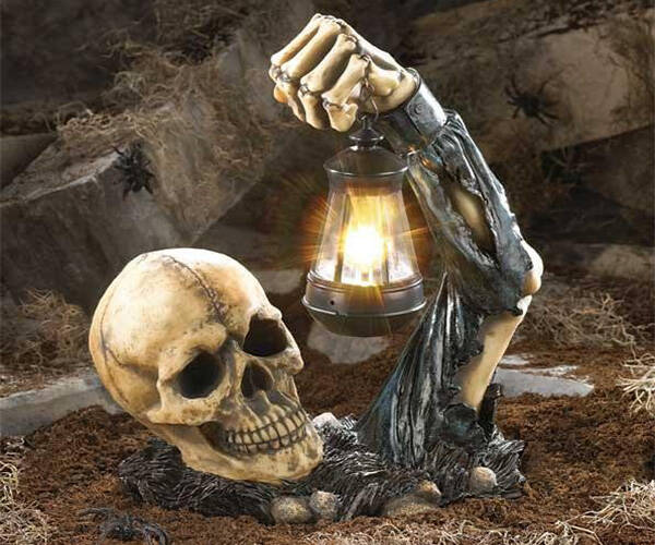 Sinister Skull with Lantern - http://coolthings.us