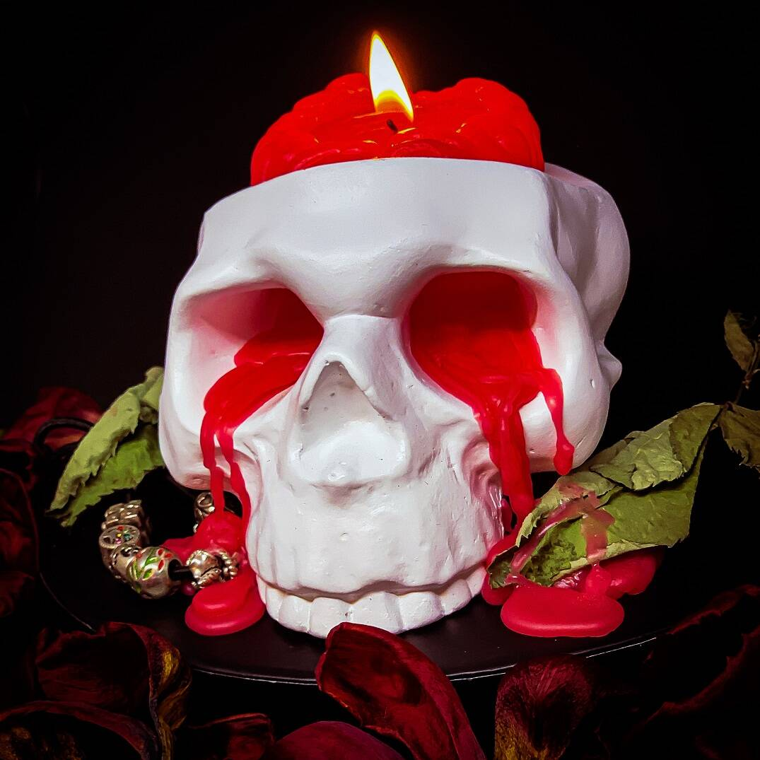 Crying Skull Candle Holder with Brain Candle - http://coolthings.us