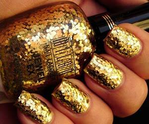 Gold Flakes Nail Polish - http://coolthings.us